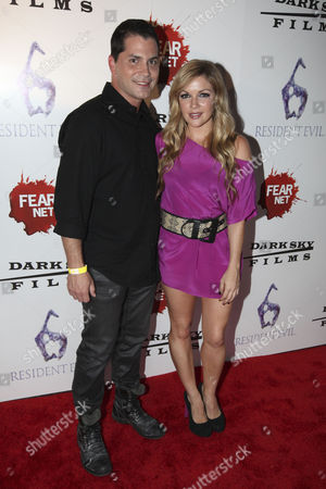 Stock Photo of Producer Adam Green and actress Corri English arrive to the Fear Net and Resident Evil Party at Voyeur Nightclub for Comic-Con weekend, in San Diego
