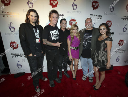 Stock Image of From left, Joe Lynch, Dave Brockie, Adam Green, Corri English, Peter Block and Laura Ortiz arrive to the Fear Net and Resident Evil Party at Voyeur Nightclub for Comic-Con weekend, in San Diego