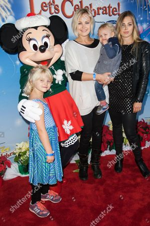 Malin Akerman, with son Sebastian Zincone and gusts attend the Disney On Ice Presents Let's Celebrate!, in Los Angeles