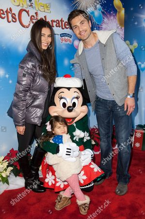 Stock Picture of Roselyn Sanchez, Eric Winter, and daughter Sebella Rose Winter attend the Disney On Ice Presents Let's Celebrate!, in Los Angeles