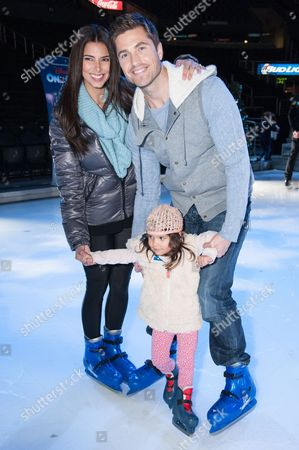 Roselyn Sanchez, Eric Winter, and daughter Sebella Rose Winter attend the Disney On Ice Presents Let's Celebrate!, in Los Angeles