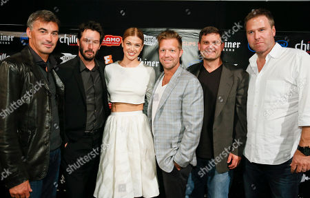 """Chad Staheiski, Keanu Reeves, Adrianne Pelicki, David Leitch, Jason Constantine, and Derek Kolstad, left to right, take part in a Q&A session following an advance screening of their new film """"John Wick"""" during Fantastic Fest at the Alamo Drafthouse- South Lamar in Austin, Texas on"""