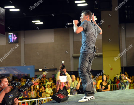 Singer/rapper Adam Irigoyen performs onstage during Festival People en Espanol 2013, on at Henry B. Gonzalez Convention Center in San Antonio, Texas