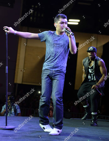 Singer/rapper Adam Irigoyen, right, performs onstage during Festival People en Espanol 2013, on at Henry B. Gonzalez Convention Center in San Antonio, Texas