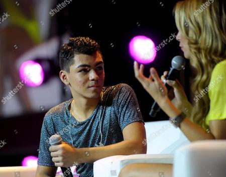 From left, singer/rapper Adam Irigoyen and TV personality Alessandra Villegas speak onstage during Festival People en Espanol 2013, on at Henry B. Gonzalez Convention Center in San Antonio, Texas