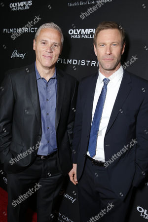 Phil Austin and Aaron Eckhart at FilmDistrict's Premiere of 'Olympus Has Fallen' hosted by Brioni and Grey Goose at the ArcLight Hollywood, on Monday, March, 18, 2013 in Los Angeles