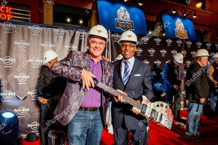 A.C. Wharton IMAGE DISTRIBUTED FOR HARD ROCK INTERNATIONAL - Hamish Dodds, President and CEO of Hard Rock International, left, and Mayor of the City of Memphis, A C Wharton, Jr., right, hold up pieces of a defective non-playable guitar they smashed alongside 14 others to commemorate the Grand Reopening of Hard Rock Cafe Memphis, on in Memphis, Tenn