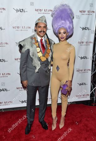 Daily Show host Trevor Noah, left, and girlfriend Jordyn Taylor attend Heidi Klum's 17th Annual Halloween Party at Vandal, in New York
