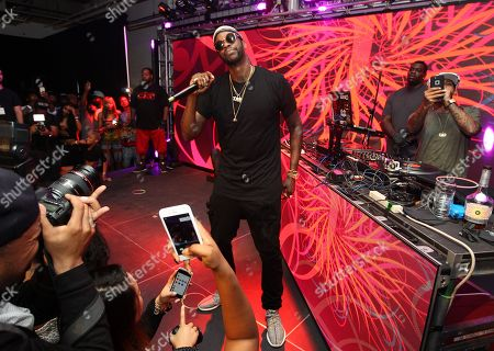 IMAGE DISTRIBUTED FOR HENNESSY - Rapper 2 Chainz, center, is seen at the Hennessy V.S. launches limited edition bottle with Ryan McGinness event at Highline Stages, on in New York