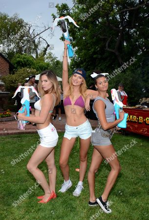 In this image distributed, Kaili Thorne, and from left, Bella Thorne, and Olivia Grace are seen at the Just Jared Summer Party in Los Angeles