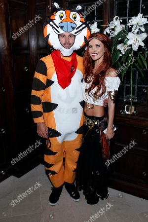 Audrina Patridge, right, and Corey Bohan are seen at the KIIS FM Halloween Party at the House of Rock benefitting The Painted Turtle, in Santa Monica, Calif