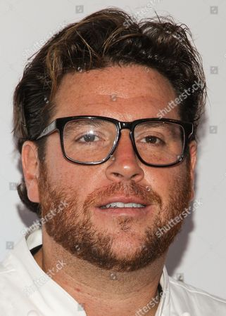 Chef Scott Conant arrives at the LA Food and Wine Festival's Festa Italiana with Giada de Laurentiis on in Los Angeles