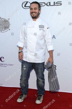 Chef Fabio Viviani arrives at the LA Food and Wine Festival's Festa Italiana with Giada de Laurentiis on in Los Angeles