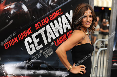 """Rebecca Budig arrives at the premiere of """"Getaway"""" at the Regency Village Theater on in Los Angeles"""