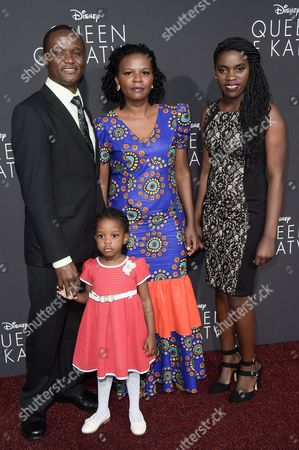 "Robert Katende and Phiona Mutesi attends the LA Premiere of ""Queen of Katwe"" held at the El Capitan Theatre, in Los Angeles"