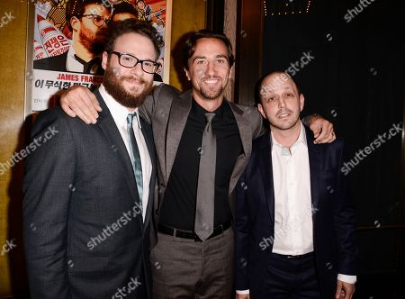 "Actor Seth Rogen, left, producer James Weaver, center, and writer Dan Sterling attend the premiere of the feature film ""The Interview"" in Los Angeles on"