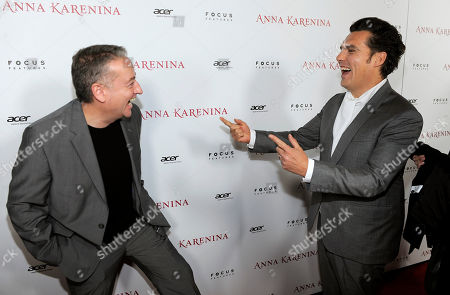 "Joe Wright, right, director of ""Anna Karenina,"" greets the film's cinematographer Seamus McGarvey at the premiere of the film at The Arclight Hollywood, in Los Angeles"