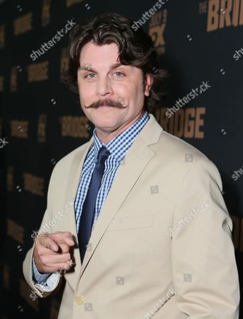 Johnny Dowers arrives at the premiere screening of 'The Bridge' at the Pacific Design Center, in West Hollywood, Calif