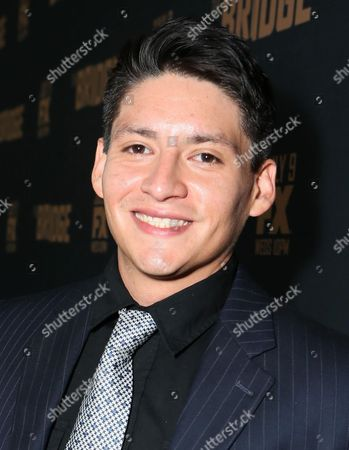 Carlos Pratts arrives at the premiere screening of 'The Bridge' at the Pacific Design Center, in West Hollywood, Calif