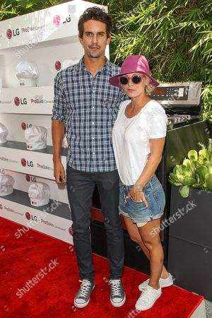 Stock Photo of Ryan Sweeting, left, and Kaley Cuoco attend the LG Fam to Table Series: ProBake Edition event held at The Washbow on in Culver City, Calif