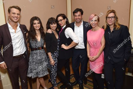 Freddie Stroma, from left, Shiri Appleby, Constance Zimmer, Sarah Gertrude Shapiro, co-creator and supervising producer, Rob Sharenow, executive vice president and general manager of Lifetime, Marti Noxon, co-creator and executive producer, and Nina Lederman, SVP, series development: Lifetime Networks, pose backstage at the Lifetime, A&E, and History winter TCA panel at the Langham Hotel, in Pasadena, Calif