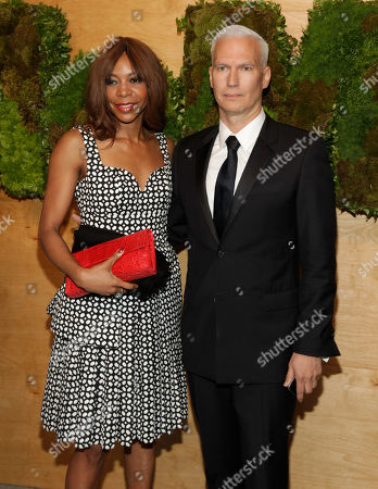 Economist Dambisa Moyo, left, and MoMA Chief Curator at Large Klaus Biesenbach, right, attend the MoMA Party in the Garden, in New York