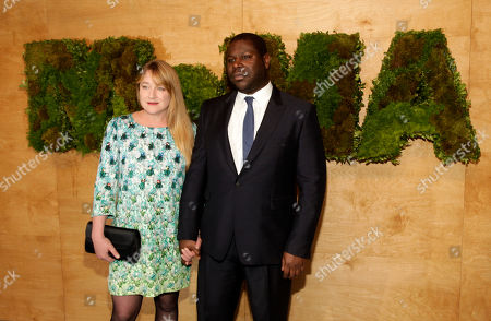 Cultural critic Bianca Stigter, left, and director Steve McQueen, right, attend the MoMA Party in the Garden, in New York