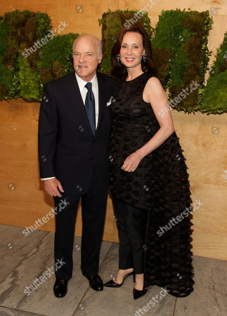 Philanthropists Henry Kravis, left, and Marie-Josee Kravis, right, attend the MoMA Party in the Garden, in New York