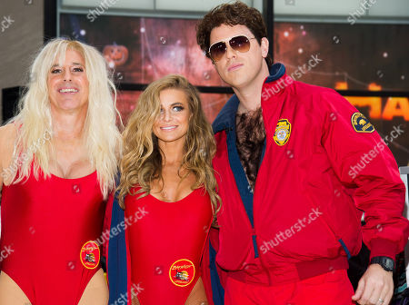 """Stock Image of Former """"Baywatch"""" star Carmen Electra, center, poses with Matt Lauer, left, dressed as Pam Anderson and Willie Geist, right, dressed as David Hasselhoff, on NBC's """"Today"""" Halloween show on in New York"""