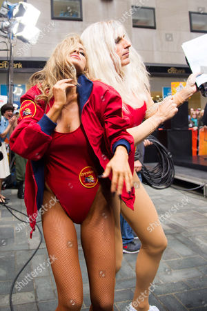 """Former """"Baywatch"""" star Carmen Electra dances with Matt Lauer dressed as Pam Anderson, on NBC's """"Today"""" Halloween show on in New York"""