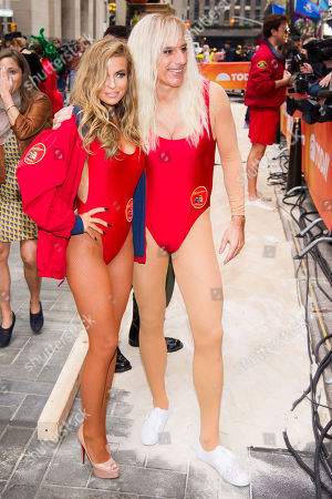 """Stock Picture of Former """"Baywatch"""" star Carmen Electra poses with Matt Lauer dressed as Pam Anderson, on NBC's """"Today"""" Halloween show on in New York"""