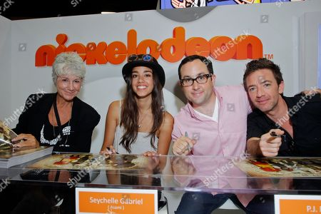 From the left, The Legend of Korra voice director Andrea Romano, actress Seychelle Gabriel, actors P. J. Byrne and David Faustino sign autographs for The Legend of Korra fans at Nickelodeon during Comic-Con, in San Diego, Calif
