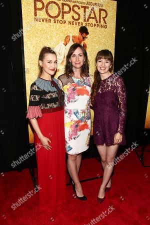 """Joanna Newsom, from left, Liz Cackowski and Marielle Heller attend the premiere of """"Popstar: Never Stop Never Stopping"""" at AMC Loews Lincoln Square, in New York"""