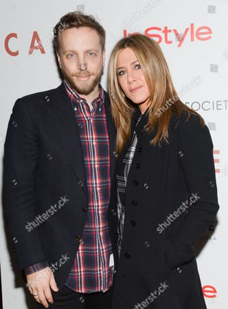 "Instyle editor-in-chief Ariel Foxman and actress Jennifer Aniston attend a special screening of ""Cake"", hosted by the Cinema Society, Instyle and Grey Goose, at the Tribeca Grand Hotel, in New York"