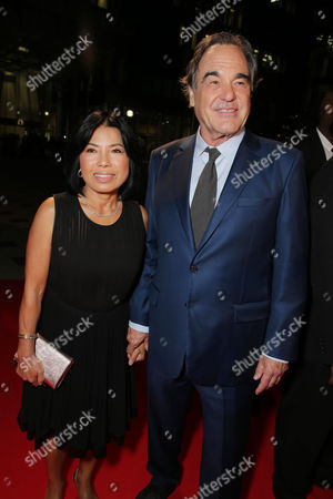 """Sun-jung Jung and Director Oliver Stone seen at Open Road Films' """"Snowden"""" premiere at 2016 Toronto International Film Festival, in Toronto"""