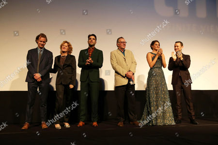 "Writer Kieran Fitzgerald, Melissa Leo, Zachary Quinto, Tom Wilkinson, Shailene Woodley and Joseph Gordon-Levitt seen at Open Road Films' ""Snowden"" premiere at 2016 Toronto International Film Festival, in Toronto"
