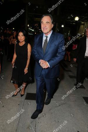 """Sun-jung Jung and Director Oliver Stone arrive at Open Road Films' """"Snowden"""" premiere at 2016 Toronto International Film Festival, in Toronto"""