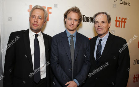 "Producer Eric Kopeloff, Writer Kieran Fitzgerald and Tom Ortenberg, CEO of Open Road Films, are seen at Open Road Films' ""Snowden"" premiere at 2016 Toronto International Film Festival, in Toronto"