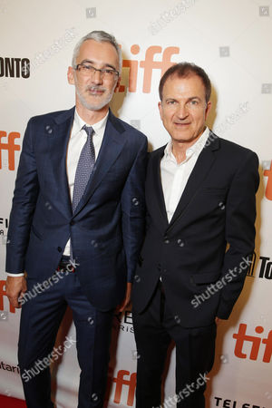 """Producer Igor Lopatonok and Producer Edward Walson seen at Open Road Films' """"Snowden"""" premiere at 2016 Toronto International Film Festival, in Toronto"""