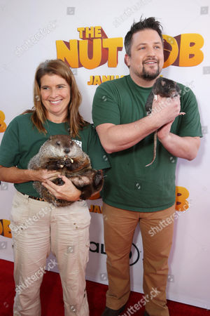 Stock Image of Naturalist Kimberly Wright with Ronald and Naturalist David Mizejewski with Buddy the Rat seen at Open Road's Premiere of 'The Nut Job', on in Los Angeles