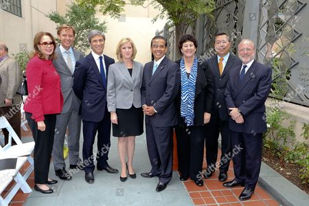 From left, Maria Hummer-Tuttle, Getty Trustee; Timothy Potts, Director, J. Paul Getty Museum; Michael Govan, CEO Los Angeles County Museum of Art and Wallis Annenberg Director; Christine Cooper, LAEDC; Antonio R. Villaraigosa, Los Angeles Mayor; Deborah Marrow, Director The Getty Foundation; Garrett Gin, Senior VP Global Marketing and Corporate Affairs, Bank of America and James Cuno, President and CEO J. Paul Getty Trust pose during the press conference to announce the economic impact of Pacific Standard Time: Art In L.A., 1945-1980 on in Los Angeles, Calif