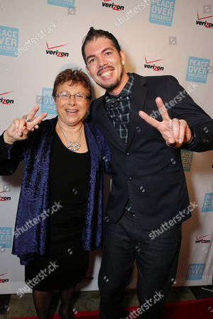 Executive Director of Peace Over Violence, Patti Giggans and Honoree Salvador Santana seen at Peace Over Violence 42nd Annual Humanitarian Awards, on Friday, Oct., 25, 2013 in Beverly Hills, Calif