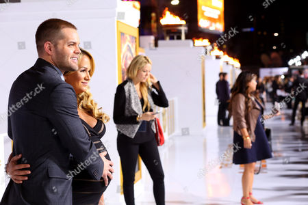 """Wes Chatham and Jenn Brown seen at the Los Angeles Premiere of Lionsgate's """"The Hunger Games: Mockingjay - Part 1"""" held at Nokia Theater L.A. Live, in Los Angeles"""