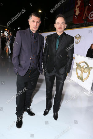 "Stock Photo of Costume designers Kurt Swanson and Bart Mueller seen at the Los Angeles Premiere of Lionsgate's ""The Hunger Games: Mockingjay - Part 1"" held at Nokia Theater L.A. Live, in Los Angeles"