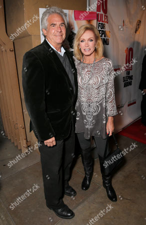 Stock Picture of Larry Gilman and Donna Mills attend the premiere of Screen Media Films' '10 Rules For Sleeping Around' at the Egyptian Theatre on in Hollywood, California