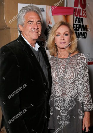 Larry Gilman and Donna Mills attend the premiere of Screen Media Films' '10 Rules For Sleeping Around' at the Egyptian Theatre on in Hollywood, California