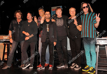 Ringo Starr, fourth from left, poses with his All Starr Band members, left to right, Gregg Rolie, Steve Lukather, Mark Rivera, Richard Page, Gregg Bissonette and Todd Rundgren following a news conference at SIR studios on in Los Angeles. Starr announced another leg of 2013 tour dates in Latin America and the U.S