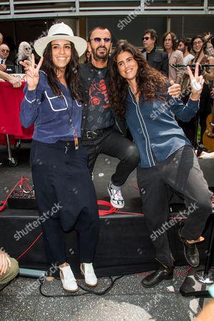 From left, Actress Olga Segura, Ringo Starr and director Francesca Gregorini attend Ringo Starr's #PEACEANDLOVE Birthday Celebration at Capitol Records on in Los Angeles