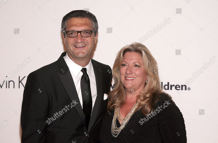 Stock Image of PVH Corporation Chairman and CEO Manny Chirico, left, and his wife Joanne Chirico, right, attend the Save The Children Benefit Gala on in New York