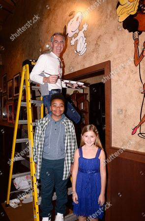 Director Steve Martino, Mar Mar and Hadley Belle Miller seen at Snoopy immortalized on the wall of the iconic Beverly Hills location of The Palm, in Beverly Hills, CA